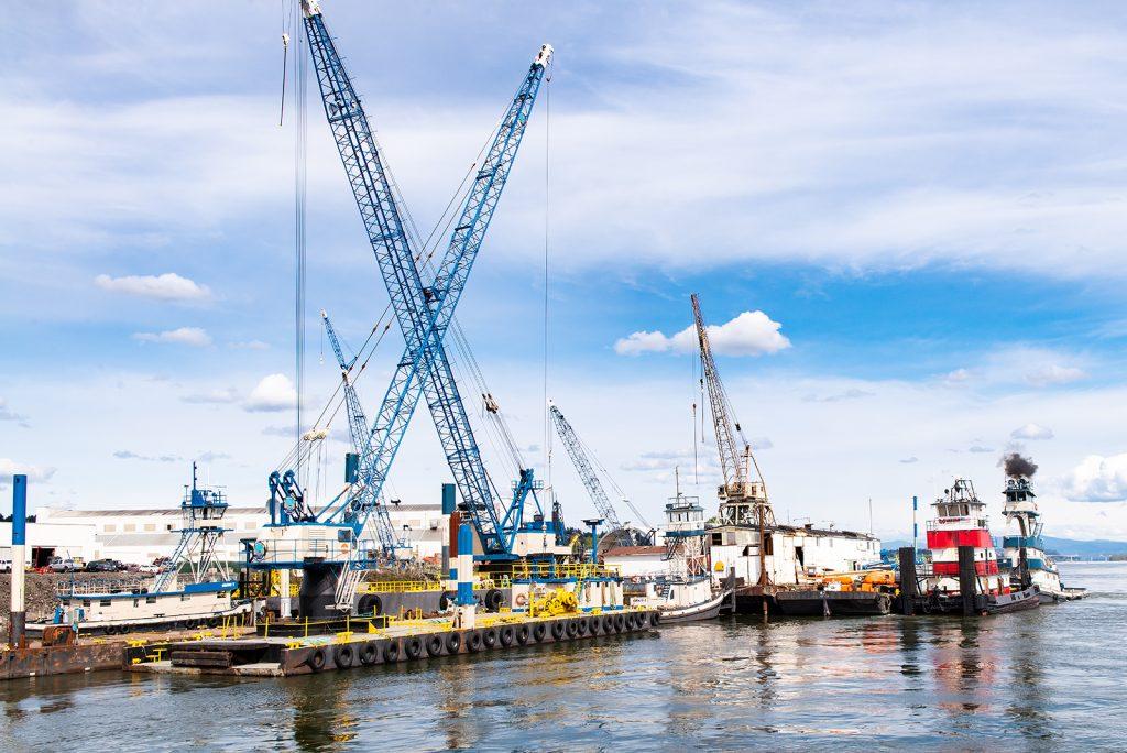 Barge cranes of JT Marine together at yard
