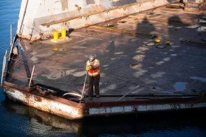 worker on construction barge