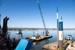 crane mounted on construction barge on columbia river